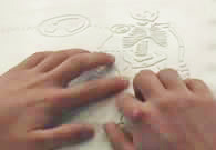 photo hand reading Tactile Graphic